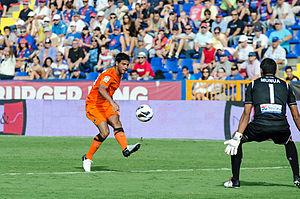 Carlos Vela - Vela shooting against Levante goalkeeper Gustavo Munúa in September 2012