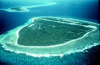 Portion of a Pacific atoll showing two islets ...