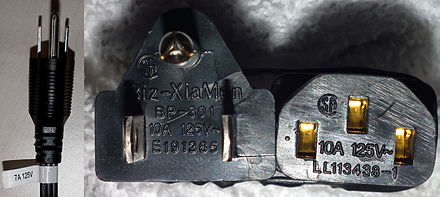 NEMA 5-15 (type B) plugs with current and voltage ratings shown (left) on label (7 A 125 V) and (centre) on engagement face (10 A 125 V). Also shown (right) is the rating on the C13 connector at the other end of the 10 A 125 V appliance cord. NEMA Plug Ratings.jpg