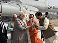 Narendra Modi being received by the Governor of Uttar Pradesh, Shri Ram Naik, the Chief Minister, Uttar Pradesh, Yogi Adityanath and the Minister of State for Culture (IC) and Environment, Forest & Climate Change.jpg