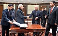 Narendra Modi writing on the visitors' book at newly inaugurated Parliament Building of Afghanistan, in Kabul on December 25, 2015. The President of Afghanistan, Dr. Mohammad Ashraf Ghani is also seen (2).jpg