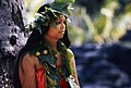 Native Hawaiian standing in front of a tree. (a5816e90b5ab4244af2f10b1d2d41e9c).jpg