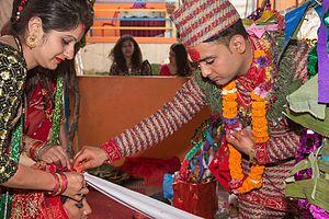 Religion in Nepal - Procession of Nepali Hindu Wedding; Groom puts Sindoor (Vermilion powder) on Bride's head