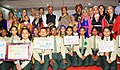 Nirmala Sitharaman along with school children and members of cultural troupe at the felicitation of the Cantonment Boards on their achievement of acquiring Open Defecation Free (ODF) certificates, in Kasauli, Himachal Pradesh.jpg