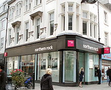 A branch of the Northern Rock bank. Some people are walking-by.