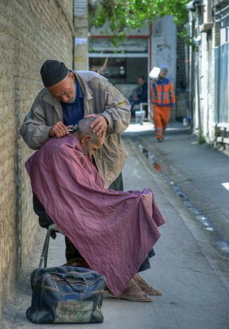 Barber - A street barber in Shiraz