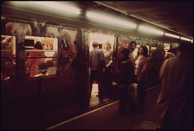 File:PASSENGERS BOARD THE NEW YORK CITY TRANSIT AUTHORITY SUBWAY ON THE LEXINGTON AVENUE LINE OBLIVIOUS TO THE GRAFFITI... - NARA - 556652.jpg