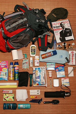 English: Packing for a trip. Equipment include...