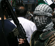 Palestinian militant with rifle