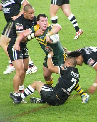 Rugby football - Rugby league: Australia's Paul Gallen looks to offload the ball from a tackle. (2008 World Cup).