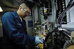 Performing maintenance 090117-N-ND508-004.jpg