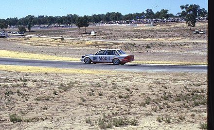 Peter Brock racing at Wanneroo in 1985 in a commodore VK Peter Brook 1985 gnangarra 1.jpg