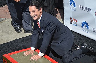 Peter Cullen - Cullen putting his handprints in wet concrete at the Optimus Prime Chinese Theatre Handprint Ceremony in September 2014