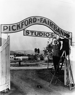 Samuel Goldwyn Studio - Mary Pickford and Douglas Fairbanks  hang the entrance signs for their Pickford-Fairbanks Studios in Hollywood