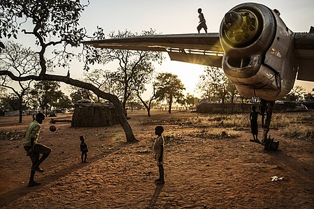 "People playing in a ""Yida refugee camp in South Sudanese territory, 20 km far from the border with Sudan,"" in 2013. This photo was the first place winner in the Wiki Loves Africa 2019 competition."