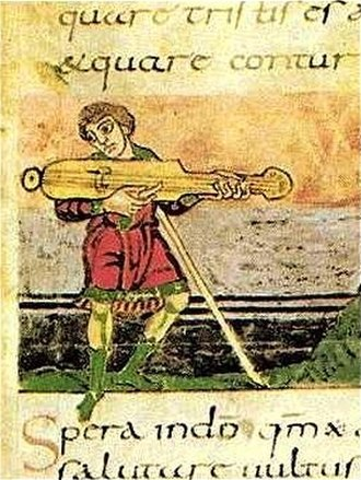 Plucked string instrument - This illustration in a French Psalter from the 9th century (c. 830) shows an unspecified plucked string instrument.