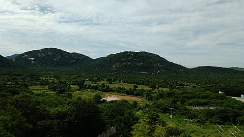 Ponds are full of water for one day rain and surrounde by full of mountains area near tirupathi.jpg