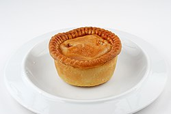 Pork pie on plate.jpg
