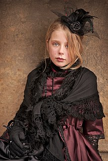 a9d2f9ffd74 Portrait of a girl in costume in the natural environment of a gothic  festival.