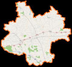 """Mapa konturowa powiatu kolskiego, blisko centrum na dole znajduje się punkt z opisem """"Grzegorzew"""""""