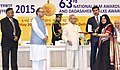 Pranab Mukherjee presenting the Rajat Kamal Award to the Producer Fisherwoman and TukTuk, Rep Smt. Nilima Eriyat for Best Animation Film, in Non-Feature Film Section, at the 63rd National Film Awards Function, in New Delhi.jpg