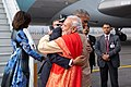 President Barack Obama, with First Lady Michelle Obama, greets Prime Minister Narendra Modi upon arrival at Air Force Station Palam.jpg