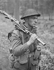 Private of the Canadian Perth Regiment advancing through forest north of Arnhem with Bren gun 1945
