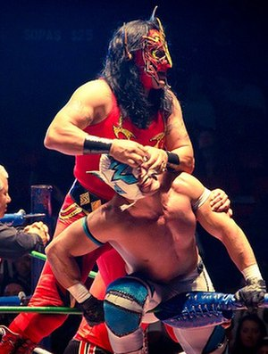 Delta (wrestler) - Delta (in front) having his mask pulled by Psicosis