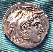 A coin depicting a cleanly-shaven Alexander the Great.
