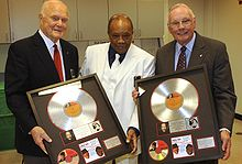 Quincy Jones presenting award records to Glenn and Neil Armstrong