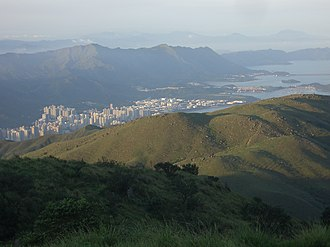 Tai Mo Shan - Tai Po, as seen from top of Tai Mo Shan. MacLehose Trail Stage 8 is visible on the ridge of the mountain on the right.