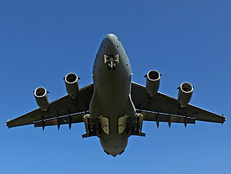 Boeing C-17 Globemaster III - A Royal Australian Air Force C-17 landing at Kharkiv International Airport, showing its landing gear