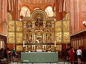 Altar - Altar in Roskilde Cathedral dwarfed by a huge carved reredos