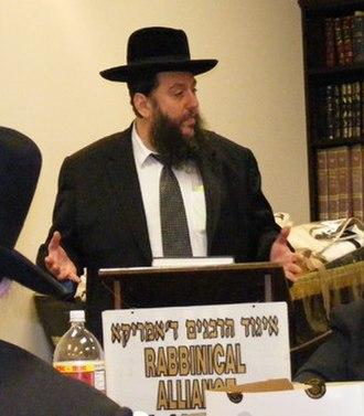 Yehuda Levin - Hosting a conference of the Igud Harabbonim