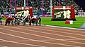 Racers competiting on the track in the Olympic Stadium (9378454620).jpg