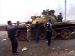 Rebels with captured T-55 at Anadan checkpoint.png