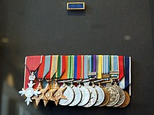 Colour photo of a group of military medals mounted on a black background