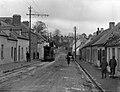 Residential Street with open top tram in Ballintemple Cork (16266759807).jpg