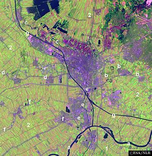 Vecht (Utrecht) - Satellite image of the surroundings of Utrecht showing river Vecht (c) and the Amsterdam-Rhine Canal (g).