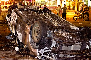 2011 Vancouver Stanley Cup riot - A car overturned and set aflame on the street during the riot
