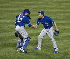 Roberto Osuna - Osuna celebrates his 20th save of the 2015 season with Russell Martin