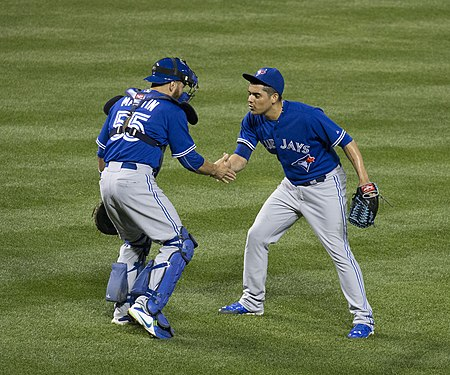 Osuna celebrates his 20th save of the 2015 season with Russell Martin Roberto Osuna and Russell Martin.jpg