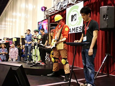 Fans try Rock Band 3 at a Comic Con convention in 2010. RockBand3ComicCon2010.JPG