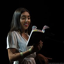 Rupi Kaur reading from her book milk and honey in Vancouver - 2017.jpg