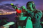 Sailor takes navigation readings aboard USS Bonhomme Richard. (29879916841).jpg
