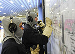 Sailors plot the status of a simulated fire during a drill aboard USS Boxer. (26233356965).jpg