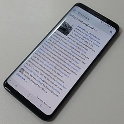 Samsung Galaxy S9+ and Wikipedia, full face, cropped.jpg