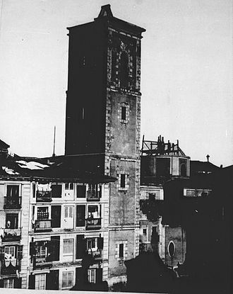 Towers of the churches of San Salvador and Santa Cruz (Madrid) - The Atalaya de la Corte in 1868 lopped in the middle of its demolition.