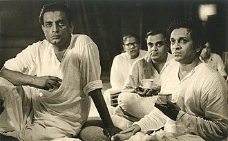 Satyajit Ray, a pioneer in Bengali cinema along with Ravi Sankar. Satyajit Ray with Ravi Sankar recording for Pather Panchali.jpg