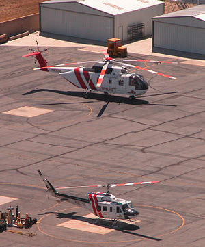 San Bernardino County Sheriff's Department - SBC Sheriff's department operates a sizable fleet of helicopters. Shown here are a Bell 212 (foreground) and a Sikorsky S-61 at the air unit's former location at Rialto headquarters. The Aviation Division was relocated to a temporary facility at the San Bernardino International Airport in January 2015 and moved into a newly built facility in July 2016.